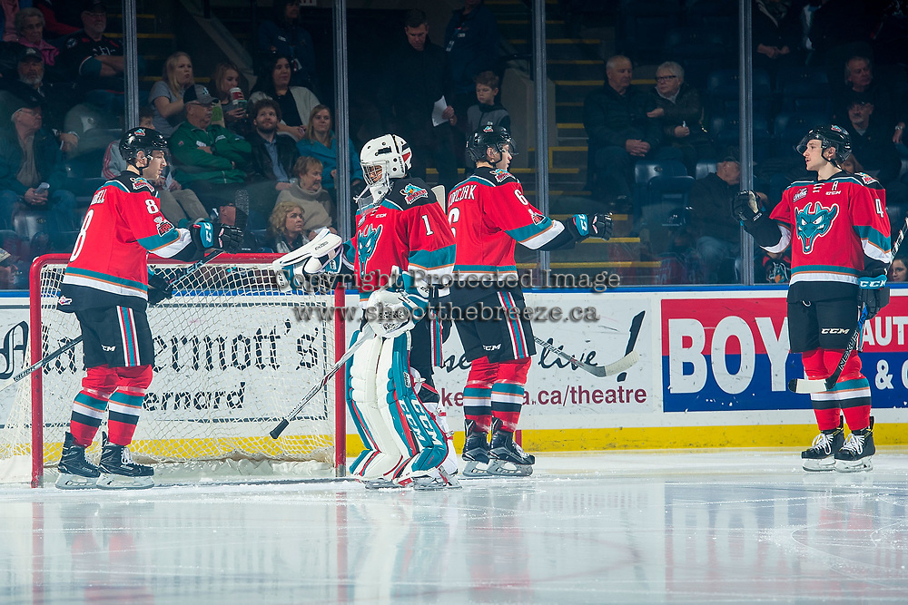 KELOWNA, CANADA - NOVEMBER 29: Jack Cowell #8, James Porter #1, Kaedan Korczak #6 and Gordie Ballhorn #4 of the Kelowna Rockets take part in a pre-game ritual against the Prince George Cougars on November 29, 2017 at Prospera Place in Kelowna, British Columbia, Canada.  (Photo by Marissa Baecker/Shoot the Breeze)  *** Local Caption ***