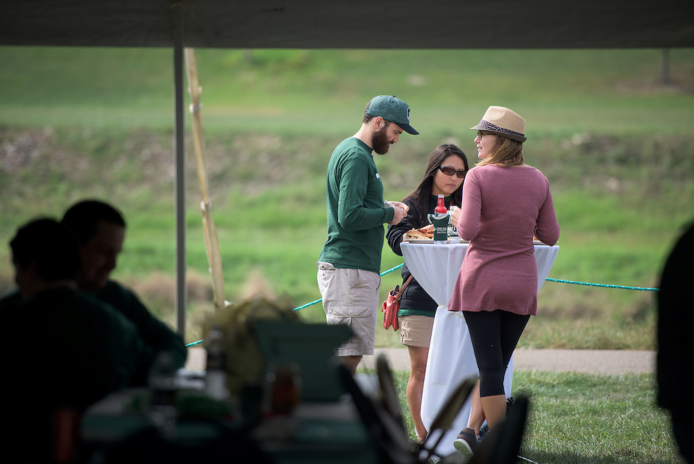 From left, Grady Bagwell, Jenny Bagwell and Darcy Ringer enjoy a lunch outside of the College of Business tent during the homecoming tailgate party at Tailgreat Park on Saturday, October 8, 2016.