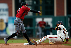 SAN FRANCISCO, CA - MAY 26: Ketel Marte #4 of the Arizona Diamondbacks completes a double play over Brandon Crawford #35 of the San Francisco Giants during the fourth inning at Oracle Park on May 26, 2019 in San Francisco, California. The Arizona Diamondbacks defeated the San Francisco Giants 6-2. (Photo by Jason O. Watson/Getty Images) *** Local Caption *** Ketel Marte; Brandon Crawford