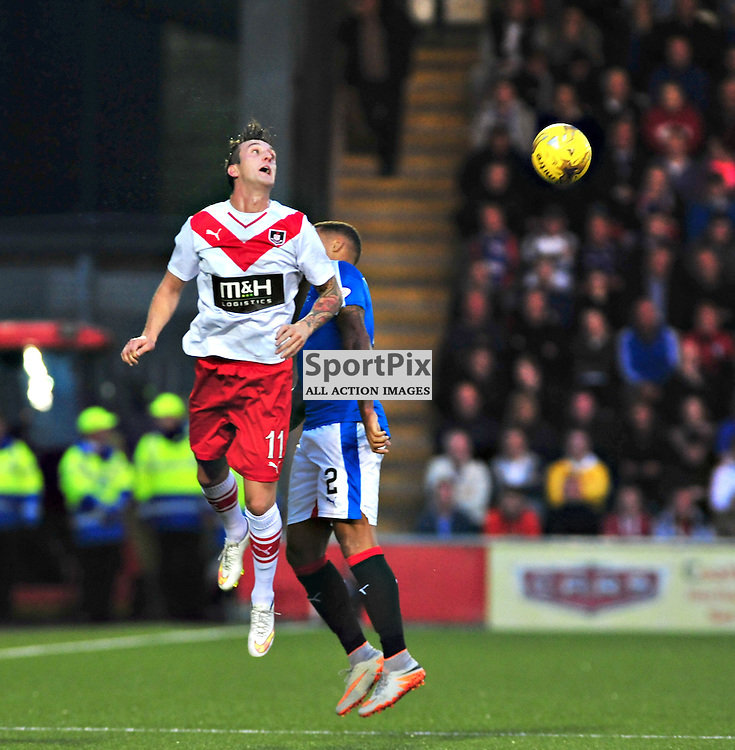 Airdrie's Jordan Morton wins an aerial challenge against Rangers<br /> <br /> (c) BILLY WHITE | SportPix.org.uk