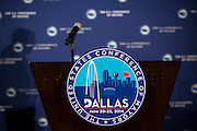 An empty podium after a press conference to begin the United States Conference of Mayors 82nd annual meeting at the Omni Hotel in Dallas, Texas on June 20, 2014.  (Cooper Neill for The New York Times)