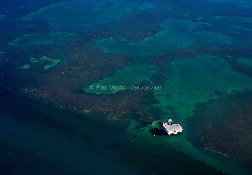 Stiltsville, houses built on a reef in the middle of Biscayne National Park off the coast of Key Biscayne, Miami Florida, showing clear blue water coral reefs.