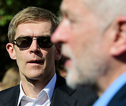 © Licensed to London News Pictures. 13/09/2016. London, UK.  Labour Party's Director of Strategy SEUMAS MILNE watches Labour Party leader JEREMY CORBYN as he attends a rally outside the Parliament in London for the Orgreave Truth and Justice Campaign. The campaign is calling for a public inquiry into the June 1984 confrontation between police and pickets at the British Steel Corporation coking plant in Orgreave, South Yorkshire. Photo credit: Ben Cawthra/LNP