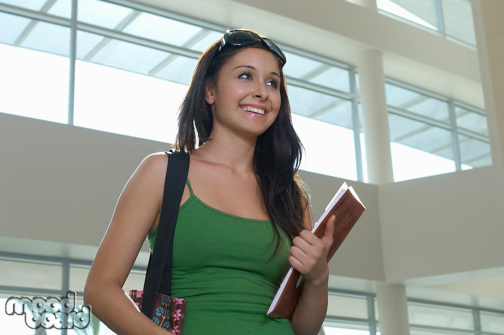Female student smiling, indoors