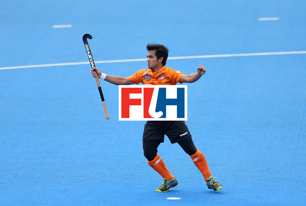 LONDON, ENGLAND - JUNE 24: Fitri Saari of Malaysia celebrates scoring their teams first goal during the semi-final match between Argentina and Malaysia on day eight of the Hero Hockey World League Semi-Final at Lee Valley Hockey and Tennis Centre on June 24, 2017 in London, England. (Photo by Steve Bardens/Getty Images)