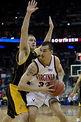 Virginia Cavaliers forward Jason Cain (33) in action against Albany.  The #4 seed Virginia Cavaliers defeated the #13 seed Albany Great Danes 84-57 in the first round of the South Region Men's NCAA Tournament in Columbus, OH on March 16, 2007.