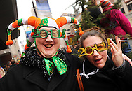 PHILADELPHIA - JANUARY 1:  Ryan Reis, and Alex Butler (R) of Wayne, Pennsylvania watch the 2011 Mummers Parade in Philadelphia, Pennsylvania. Thousands of people enjoyed the warmer weather and watched the parade, which has been around for over 100 years. (Photo by William Thomas Cain/Getty Images)