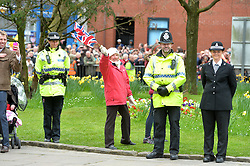 Royal supporters and police watch as the Queen and Duke of Edinburgh leave  Blackburn Cathedral. <br /> The Queen and Duke of Edinburgh attend the Royal Maundy Service at Blackburn Cathedral.<br /> Thursday 17th of April 2014. Picture by Ben Stevens / i-Images