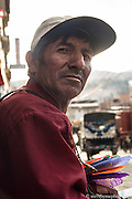 Don Julio, ambulant seller of fly swatters and mouse traps.  Whilest sitting on a curb in an alley adjacent to Huaraz's central market, Julio approached me and asked about my work.  We chatted for some time until he asked me to make his portrait as the light behind him diffused through the haze of nearby cooking smoke.