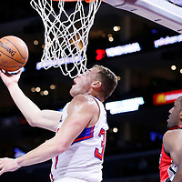 27 December 2014: Los Angeles Clippers forward Blake Griffin (32) goes for the reverse layup past Toronto Raptors forward Patrick Patterson (54) during the Toronto Raptors 110-98 victory over the Los Angeles Clippers, at the Staples Center, Los Angeles, California, USA.