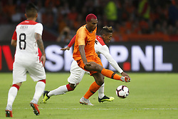 (L-R), Christian Cueva of Peru, Ryan Babel of Holland, Pedro Aquino of Peru during the International friendly match match between The Netherlands and Peru at the Johan Cruijff Arena on September 06, 2018 in Amsterdam, The Netherlands