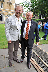 Left to right, MAJOR KEN HAMES and ANDREW NEIL at the annual House of Lords vs House of Commons Tug of War in aid of Macmillan Cancer Support held in College Garden, Westminster Abbey, London on 9th June 2009.