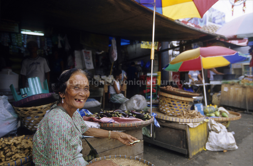OLD WOMAN IN A MARKET, BAGUIO, LUZON, PHILIPPINES