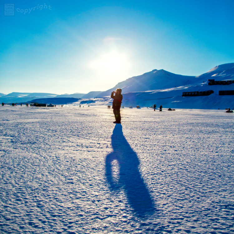 Person taking picture on Svalbard, Norway during the 2015 total solar eclipse