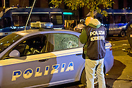 Roma 11 Novembre 2014<br /> Un centinaio di abitanti del quartiere Tor Sapienza ha assaltato  nella tarda serata il centro di accoglienza  per rifugiati in via Morandi, che ospita immigrati richiedenti asilo politico.  Durante l'assalto, sono state lanciate verso l'edificio che ospita 36 migranti,  diverse bombe carta, 4 poliziotti sono rimasti feriti, cassonetti incendiati e usati come barricate. Una auto della polizia danneggiata dai manifestanti<br /> Rome November 11, 2014<br /> One hundred of the inhabitants Tor Sapienza neighborhood, attacked late in the evening the reception center for refugees in Morandi street,  where they live to immigrants applicants political asylum. During the assault were thrown at the building that houses 36  migrant, several paper bombs, four policemen were injured, bins on fire and used as barricades. A police car was damaged by protesters