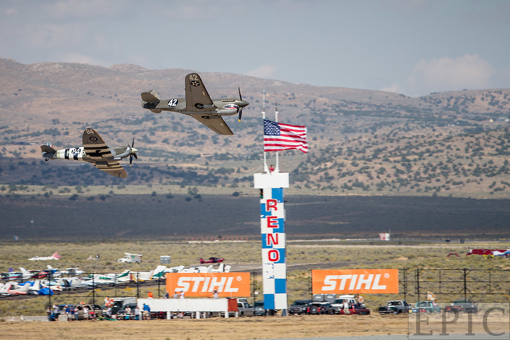 RENO, NV - SEPTEMBER 14: Planes fly close together in the unlimited class at the Reno Championship Air Races on September 14, 2017 in Reno, Nevada. (Photo by Jonathan Devich/Getty Images) *** Local Caption ***