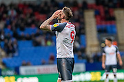 Daryl Murphy of Bolton Wanderers holds his head in frustration during the EFL Sky Bet League 1 match between Bolton Wanderers and Milton Keynes Dons at the University of  Bolton Stadium, Bolton, England on 16 November 2019.