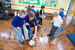 Children with disabilities playing indoor football,