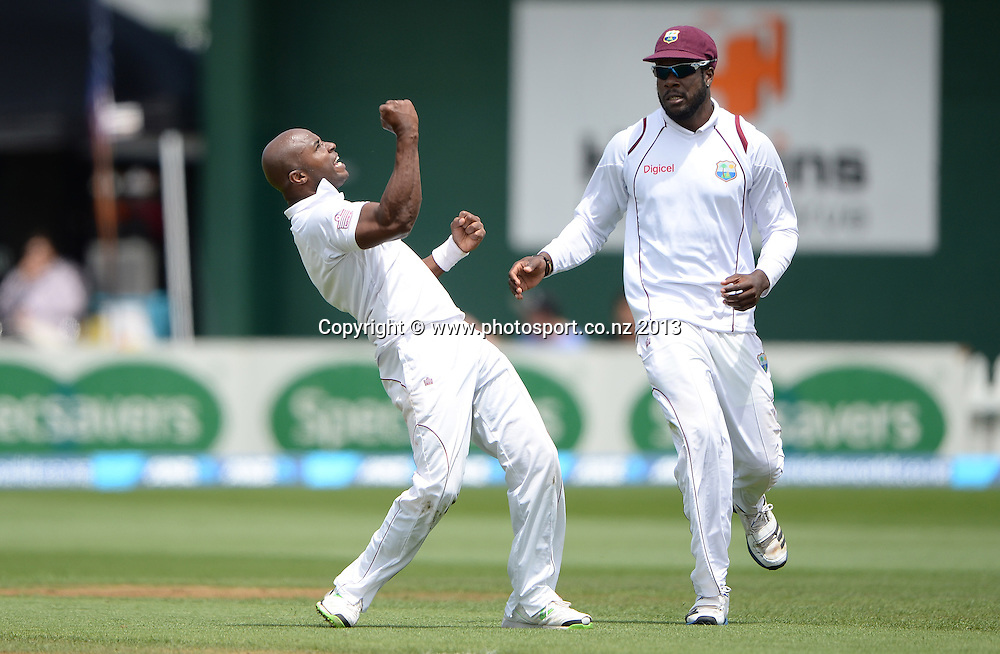 Tino Best celebrates the wicket of Kan Williamson as Kirk Edwards looks on during play on Day 1 of the 2nd cricket test match of the ANZ Test Series. New Zealand Black Caps v West Indies at The Basin Reserve in Wellington. Wednesday 11 December 2013. Mandatory Photo Credit: Andrew Cornaga www.Photosport.co.nz