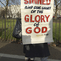 Man holding a Christian banner at the Speaker's corner, Hyde Park, London