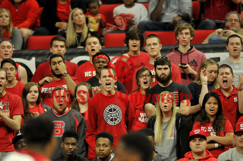 Wolfpack fans cheer their team as the first half comes to a close.