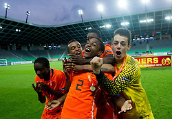 Players of Netherlands Queensy Menig of Netherlands, Jeroen Lumu of Netherlands, Djavan Anderson of Netherlands, Riechedly Bazoer of Netherlands and Nick Olij of Netherlands celebrate after winning the UEFA European Under-17 Championship Final match between Germany and Netherlands on May 16, 2012 in SRC Stozice, Ljubljana, Slovenia. Netherlands defeated Germany after penalty shots and became European Under-17 Champion 2012. (Photo by Vid Ponikvar / Sportida.com)