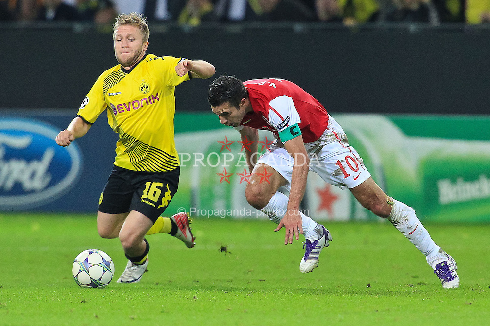 13.09.2011, Signal Iduna Park, Dortmund, GER, UEFA CL, Gruppe F, Borussia Dortmund (GER) vs Arsenal London (ENG), im Bild.Kuba (Dortmund #16) gegen Robin van Persie (Arsenal #10)..// during the UEFA CL, group F, Borussia Dortmund (GER) vs Arsenal London on 2011/09/13, at Signal Iduna Park, Dortmund, Germany. EXPA Pictures © 2011, PhotoCredit: EXPA/ nph/  Mueller       ****** out of GER / CRO  / BEL ******