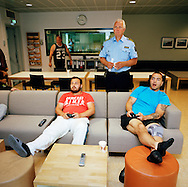Halden Prison, Norway, June 2014:<br /> Inmates playing TV games on a large TV screen in the common area in C8, a special unit for addiction recovery. Governor Are H&oslash;idal standing.<br /> -- No commercial use --<br /> Photo: Knut Egil Wang/Moment/INSTITUTE