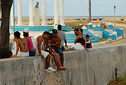 HAVANA, CUBA - OCTOBER 22, 2006: Unidentified people relax at the sea-front in Cojimar, Cuba. Cojimar was the place where Ernest Hemingway wrote The Old Man and the Sea.
