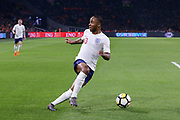 England midfielder Raheem Sterling looks the other way attacking the goal during the Friendly match between Netherlands and England at the Amsterdam Arena, Amsterdam, Netherlands on 23 March 2018. Picture by Phil Duncan.