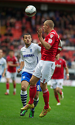 LONDON, ENGLAND - Saturday, October 8, 2011: Tranmere Rovers' Mustafa Tiryaki and Charlton Athletic's Michael Morrison during the Football League One match at The Valley. (Pic by Gareth Davies/Propaganda)