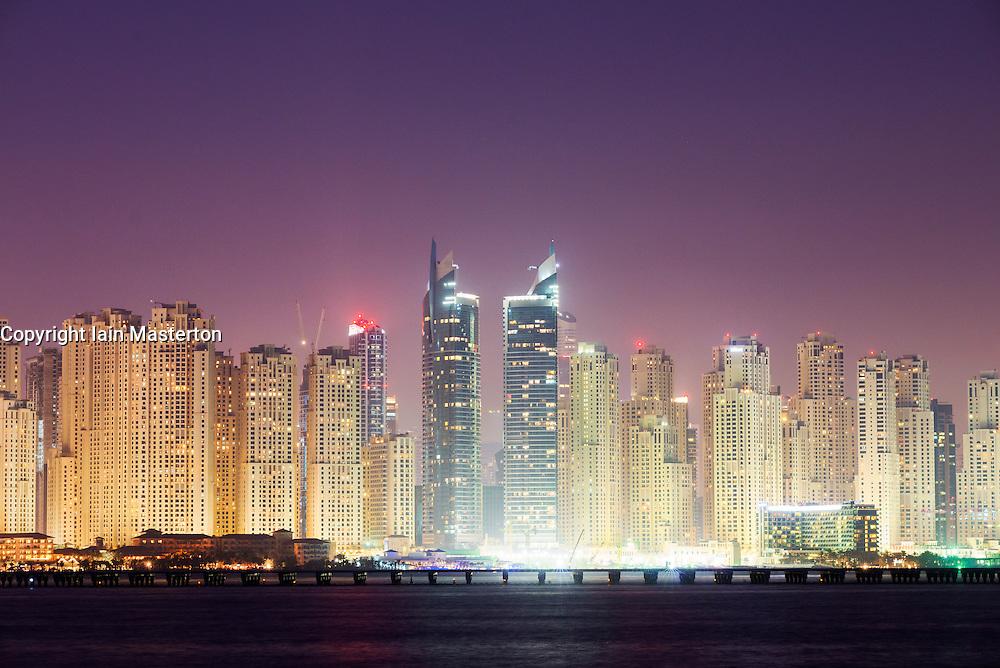 Night view of residential towers at Jumeirah Beach Residence (JBR) at Marina in Dubai United Arab Emirates