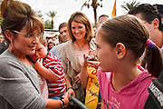 22 OCTOBER 2010 - PHOENIX, AZ:  SARAH PALIN talks a middle school student at a Tea Party rally in Phoenix. About 300 people attended a Tea Party rally on the lawn of the Arizona State Capitol in Phoenix Friday. They demanded lower taxes, less government spending, repeal of the health care reform bill, and strengthening of the US side of the US - Mexican border. They listened to Arizona politicians and applauded wildly when former Alaska Governor Sarah Palin and her son, Trig, made a surprise appearance. The event was a part of the Tea Party Express bus tour that is crossing the United States.     Photo by Jack Kurtz