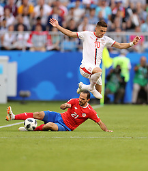 SAMARA, June 17, 2018  Dusan Tadic (top) of Serbia vies with Marco Urena of Costa Rica during a group E match between Costa Rica and Serbia at the 2018 FIFA World Cup in Samara, Russia, June 17, 2018. (Credit Image: © Fei Maohua/Xinhua via ZUMA Wire)