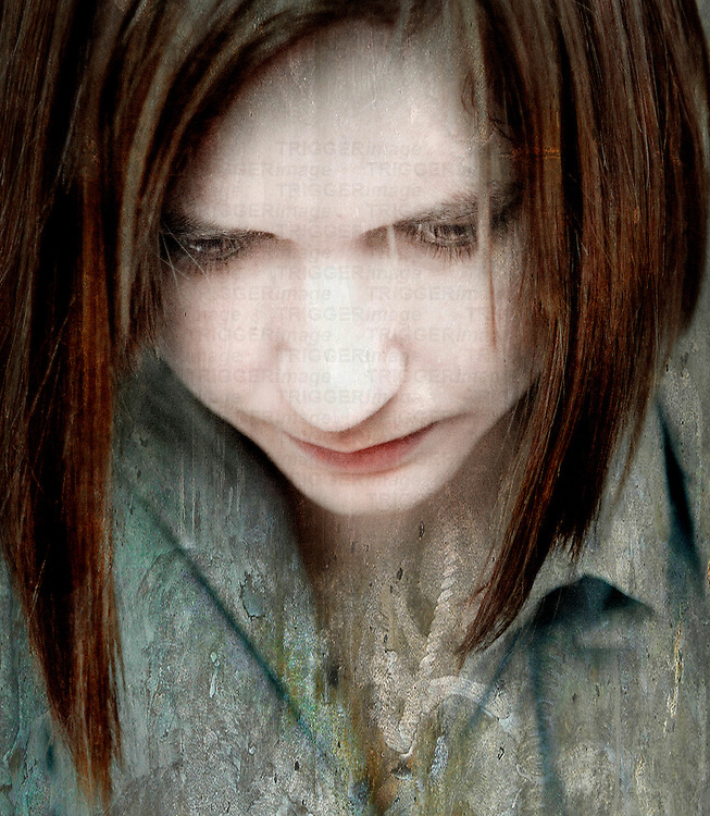 Close up of a distressed young woman looking down