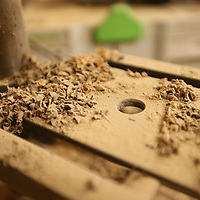 Wood shavings and dust have built up on Keith's drill press over the years at his shop behind his house.