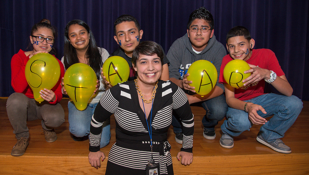 Chavez High School instructor Christie Saldivar poses with members of her freshmen freshman after they won a STAAR relay contest during a rally, March 27, 2014.