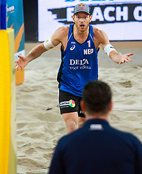 06-01-2019 NED: Dela Beach Open, Den Haag<br /> Netherlands lost the bronze medal from Russia 1-2 /  Alexander Brouwer #1 is furious on the referee after the stolen ball of Ilya Leshukov #1 and lost the rally 14-12.