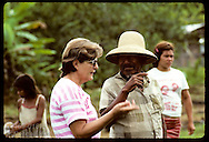 German woman of New Tribes evangelical mission talks to Kanamari chief at Tres Unidos, Amazonas. Brazil