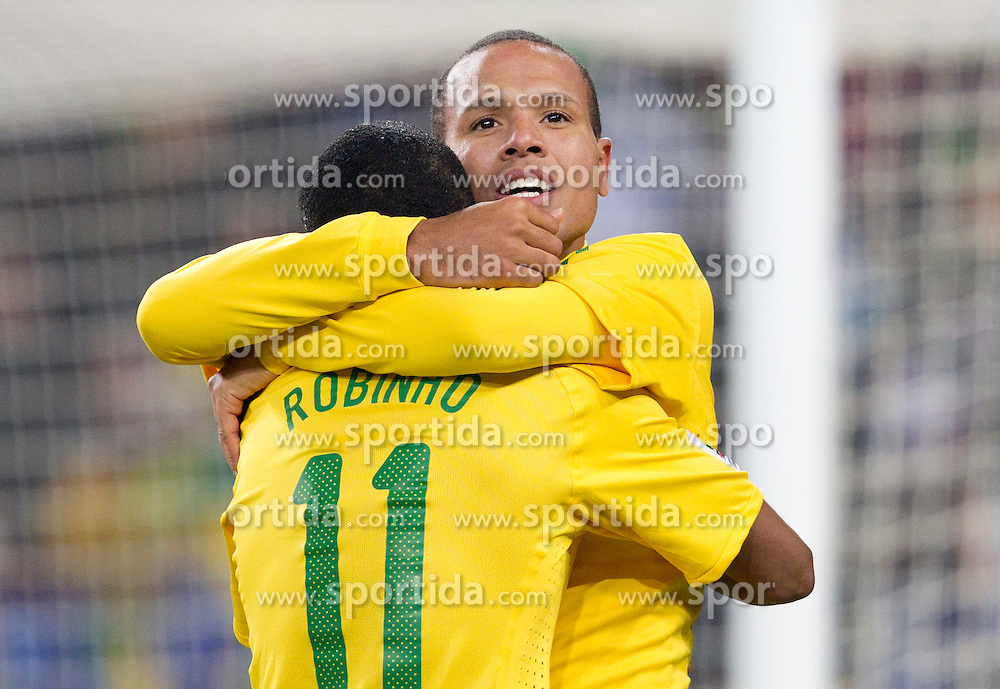 Luis Fabiano and Robinho of Brazil celebrate after Luis Fabiano scored second time during the 2010 FIFA World Cup South Africa Group G Second Round match between Brazil and République de Côte d'Ivoire on June 20, 2010 at Soccer City Stadium in Soweto, suburban Johannesburg, South Africa. (Photo by Vid Ponikvar / Sportida)