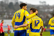 Accrington Stanley's Matt Crooks congratulates Accrington Stanley's goal scorer Shay McCartan during the Sky Bet League 2 match between Exeter City and Accrington Stanley at St James' Park, Exeter, England on 23 January 2016. Photo by Graham Hunt.