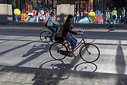Women cyclists ride along Slovenska Cesta (Street) in the Slovenian capital, Ljubljana, on 26th June 2018, in Ljubljana, Slovenia. Ljubljana is a small city with flat terrain and a good cycling infrastructure. It was featured at eighth on the 'Copenhagenize' index listing the most bike-friendly cities in the world.