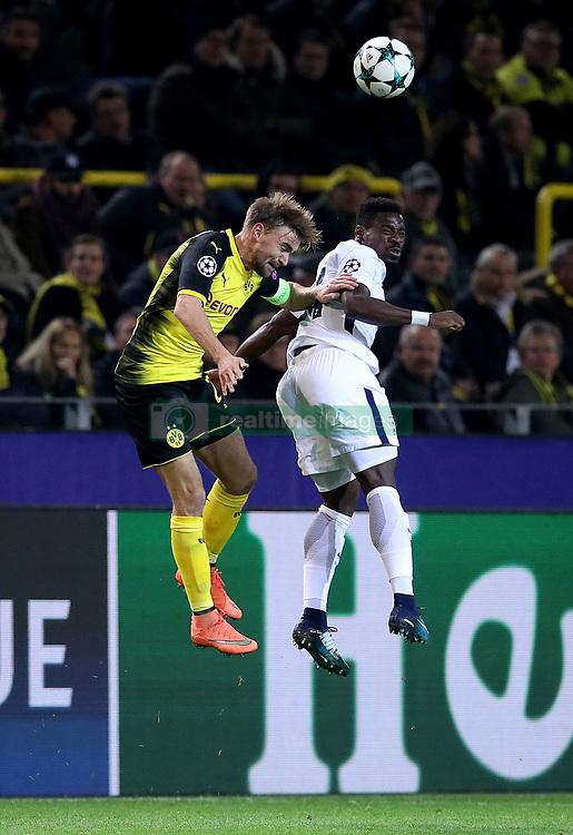 Borussia Dortmund's Marcel Schmelzer (left) and Tottenham Hotspur's Serge Aurier (right) battle for the ball