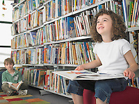 Elementary Student Reading in Library