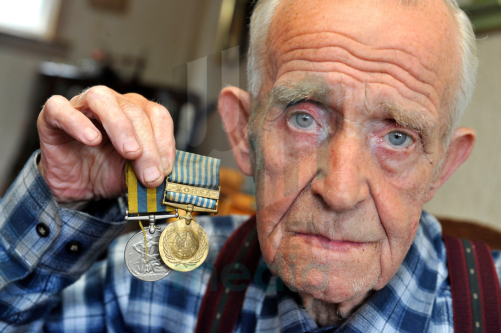 Korean War veteran Hugh Urquhart with his medals.
