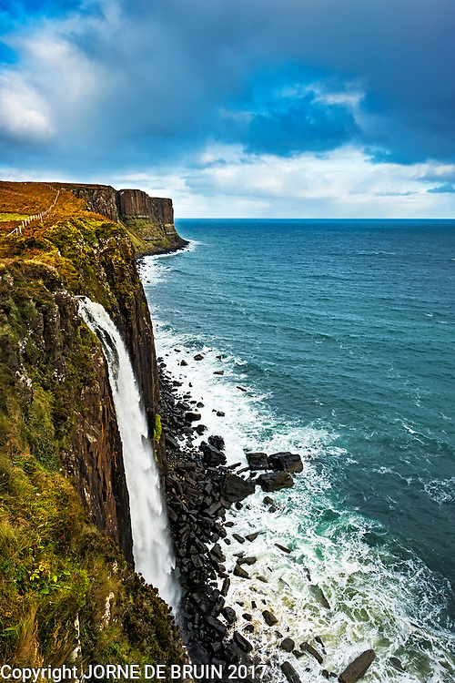The Famous Kiult Rock waterfall o the Isle of Skye plunges straight of the cfillss into the sea.