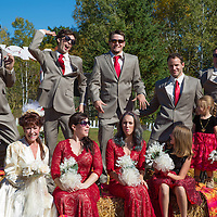 An October wedding. The Bride wore a classic wedding dress from 1945. Wedding party wore red accents. The venue was a country theme. The boys were having fun.  JUMP!!