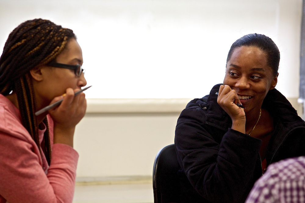 Students at Montgomery College, including Dominique Parrish, right, and Candra Robinson, brainstorm ideas on their group's final project in their Basic Writing II class at the Takoma Campus on Dec. 11, 2012. If students pass this class, it allows them to progress to the college level english program. Otherwise students will face the decision to take the remedial class again or drop out.