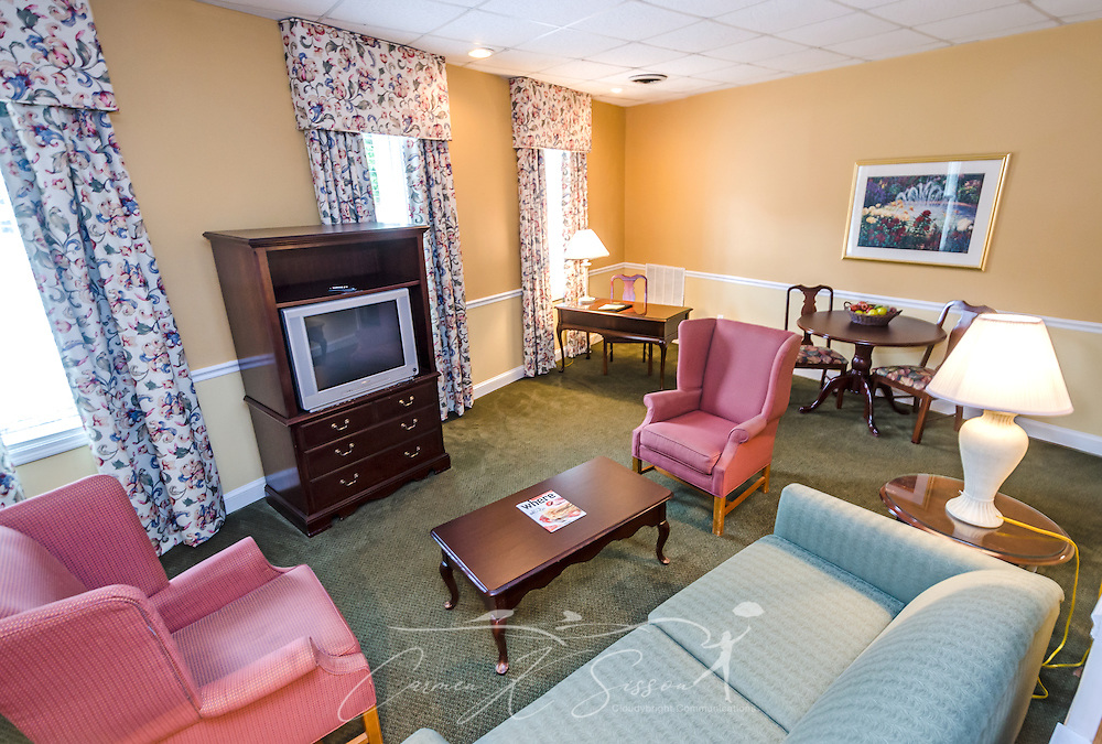 """The guest house living room is spacious at University Inn, a family-owned hotel located near Emory University in Atlanta, Georgia, May 29, 2014. The inn opened in January 1971 and offers 60 rooms to meet the lodging needs of University parents and other Atlanta visitors. It was featured on the Travel Channel's """"Hotel Impossible,"""" May 26, 2014. (Photo by Carmen K. Sisson/Cloudybright)"""