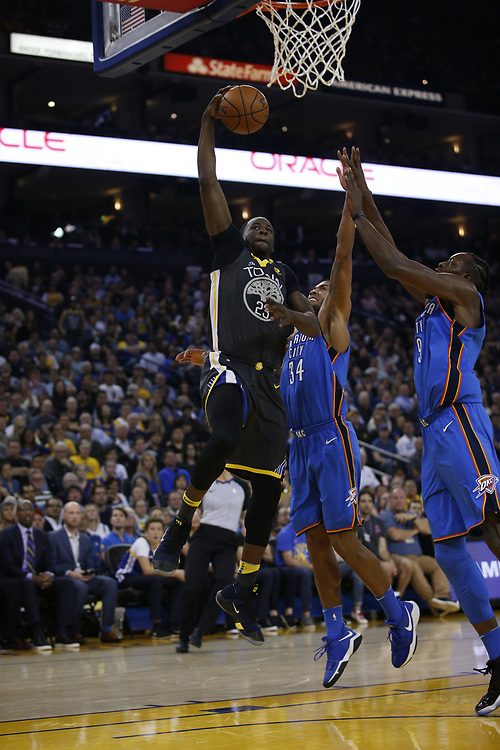 Golden State Warriors forward Draymond Green (23) lays up a shot during the first half of an NBA game between the Warriors and Oklahoma City Thunder at Oracle Arena, Tuesday, Feb. 6, 2018, in Oakland, Calif.
